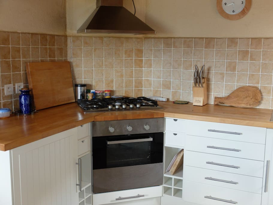 Open plan kitchen with gas hob and electric oven.