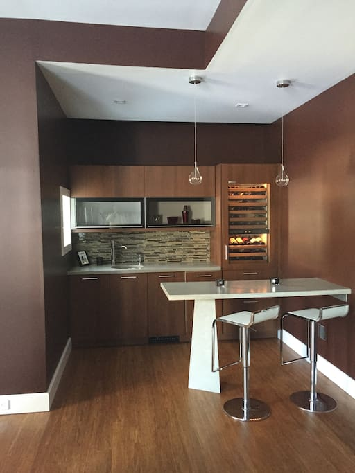 Full high end sub zero wine bar, ice maker, fridge drawers and a microwave in adjoining cabinet