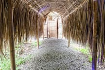 A covered walkway between the cabana and outdoor bathroom
