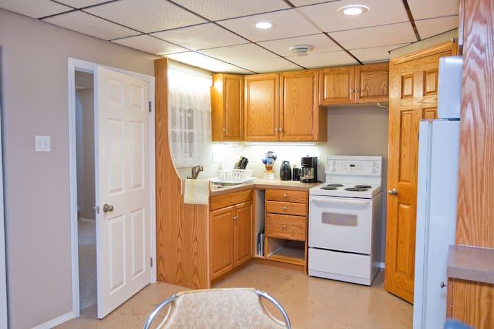 Kitchen features double sink, stove fridge & pantry.