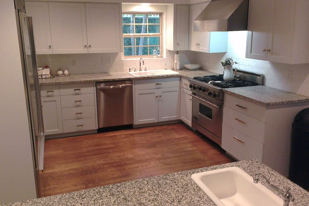 Updated kitchen with stainless appliances and ample counter space offer numerous options for cooking in!
