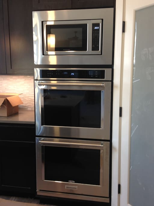 Double oven and microwave for cooking family meals.