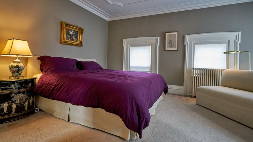 A comfy King size bed awaits adorned with fine cotton linens.
