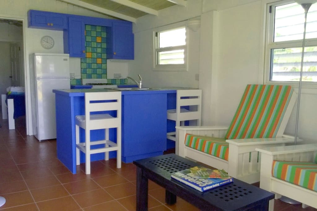 Bright sitting area and kitchen in The Sloop