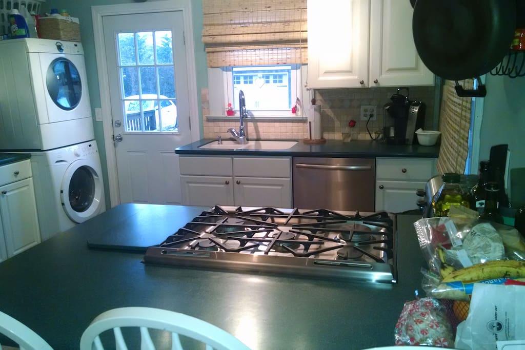 Open kitchen, breakfast bar, sub-zero frig, dish washer, laundry center.