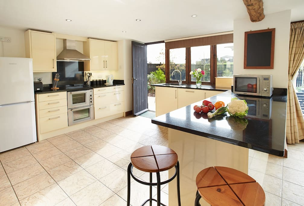 Ground floor: Large open-plan kitchen/dining and sitting room with wood burning stove
