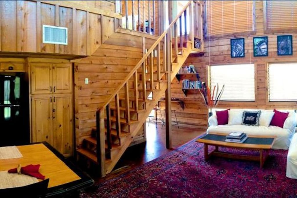 The stairs leading the loft and upper deck, from the kitchen/living area.