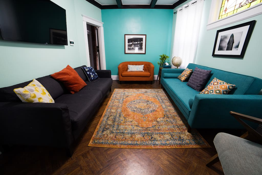 "The main living room has one mid-century futon (which can sleep 2, a firm bed), one sleeper couch (which can sleep 2, a softer bed) and a love seat. It also has a 55"" TV with ESPN, HBO, Netflix, etc."