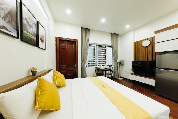 Full-furnished studio with bathroom, kitchen, dining table, washing machine in the room