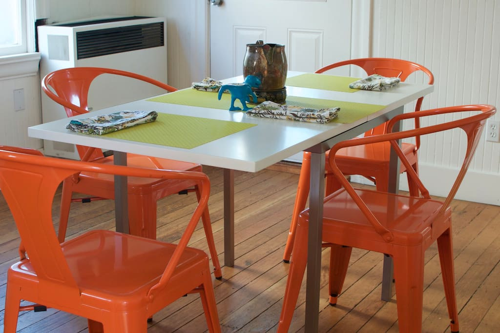 This colorful, charming dining area awaits you.