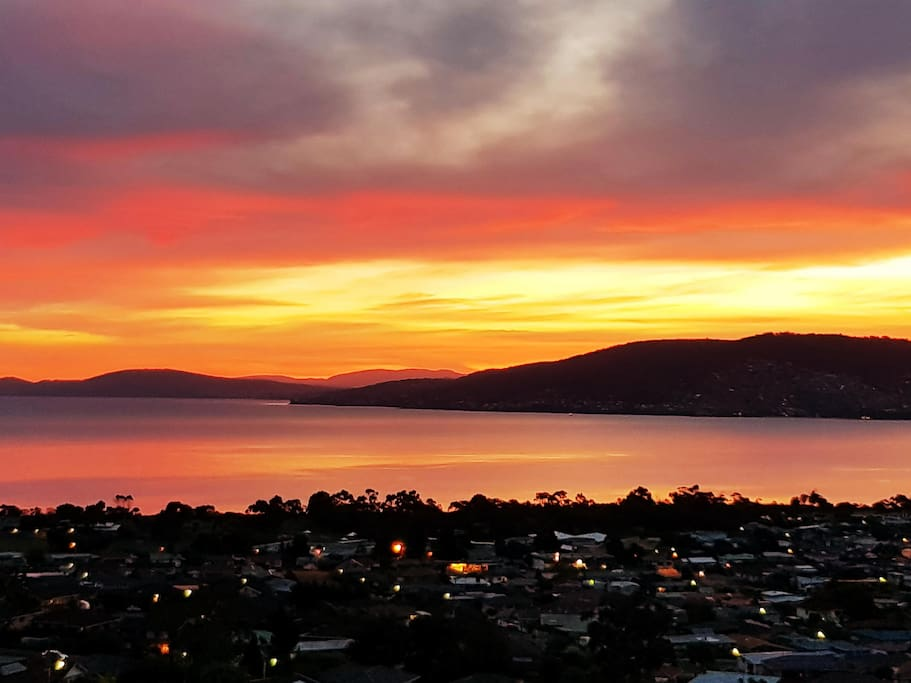 Come and enjoy a kaleidoscope of colours from your private balcony as the sun sets over Hobart.