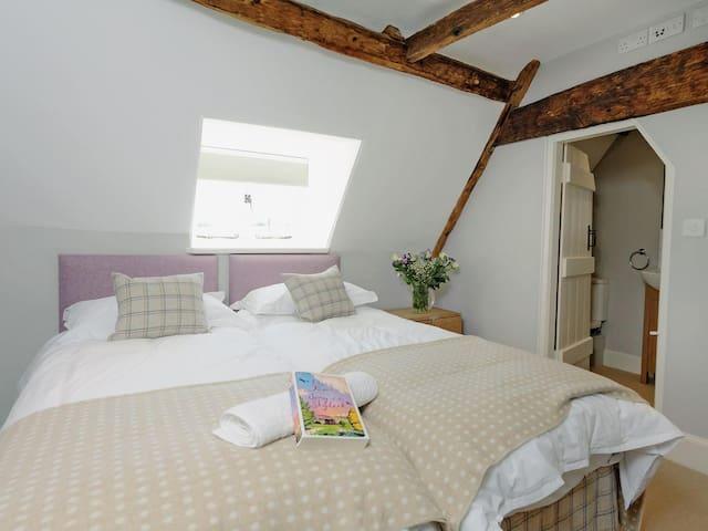 Bedroom Five (2nd Floor) with twin beds and ensuite bathroom