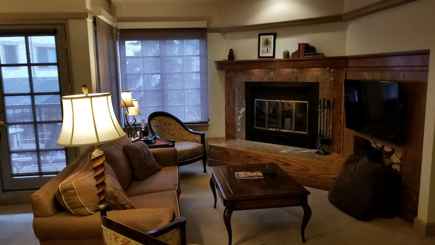 comfortable living with wood burning fireplace