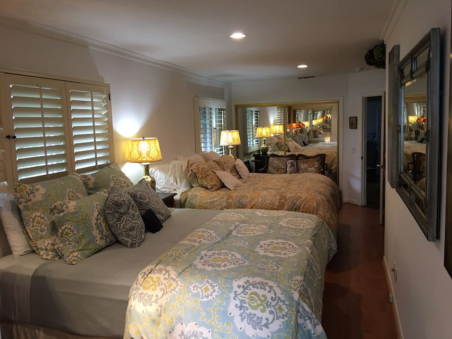 Two Cal King beds. Very comfy! Two mirrored closets in opposite walls.