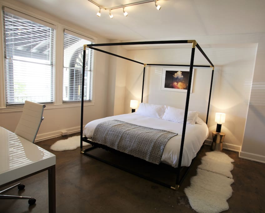 Master Bedroom with king-size canopy bed and desk