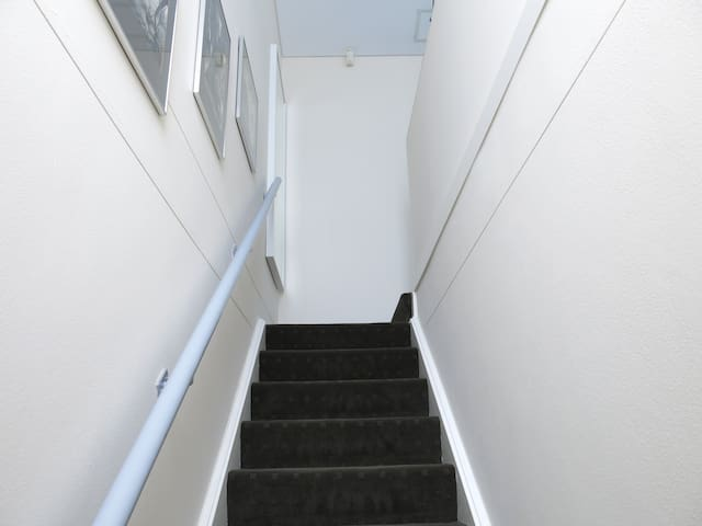 Staircase leading to the studio