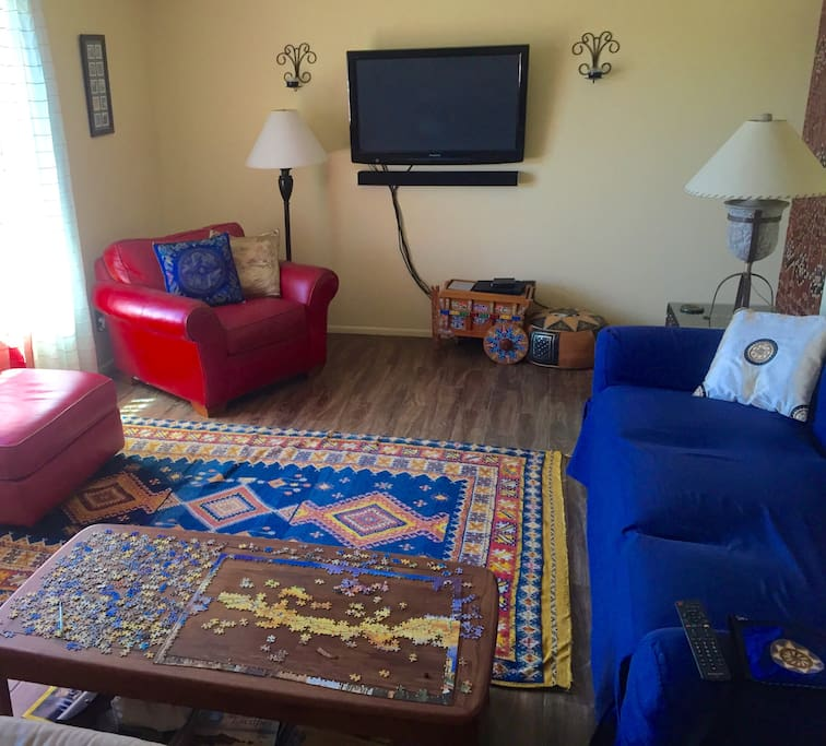 Living room: rug from Morocco, cart from Costa Rica, new tile.