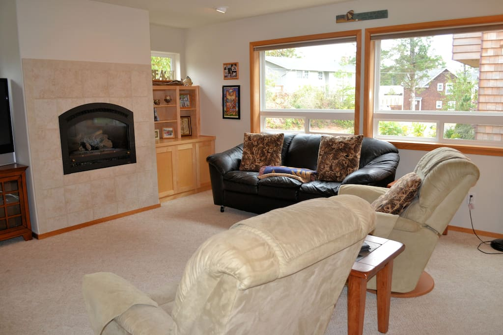 Living room with 2 reclining chairs, sofa, gas fireplace, and TV