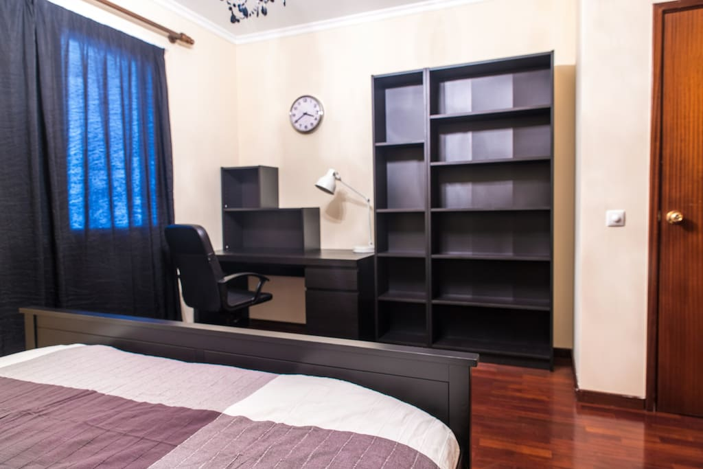 master bedroom with convenient work station and wireless-charing lamp