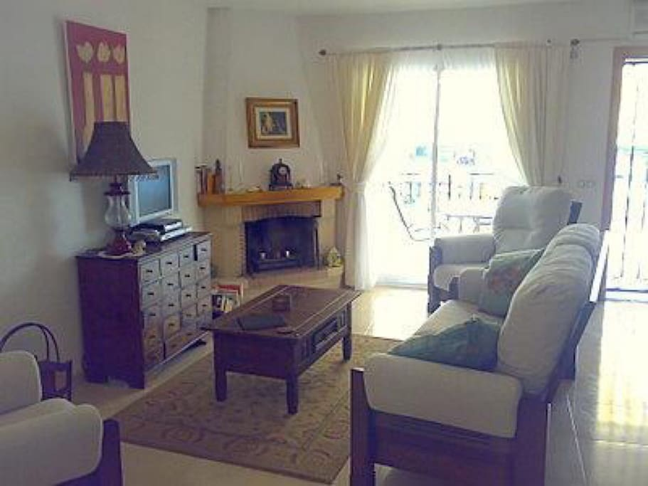 Comfortably furnished living room with TV, English satellite & media box for movies galore