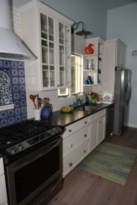 A fully stocked cook's kitchen - everything you need -all-clad pots, Fiesta ware