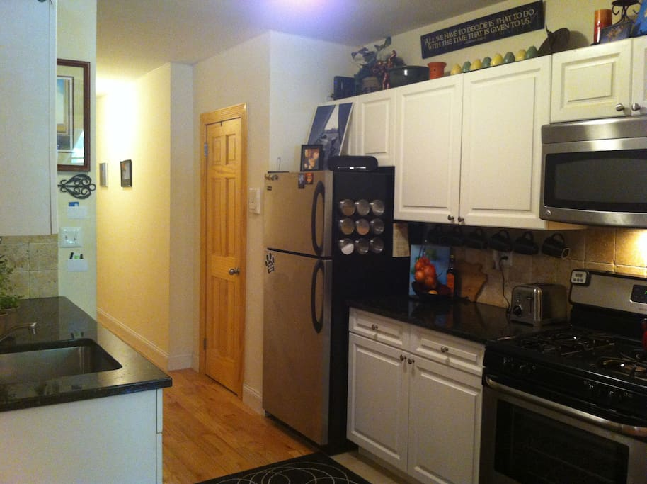Large Walk-through kitchen. New Stainless appliances and fully stocked with dishes, utensils, cookware and other necessities. Full Stainless Fridge/Freezer, Microwave, Dishwasher & Stove/oven