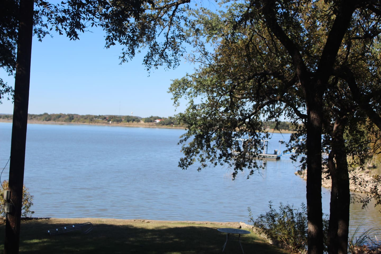 Lakeside Cottage back yard is right on the water! A great place for fishing or swimming and a paddle boat is available for your use.