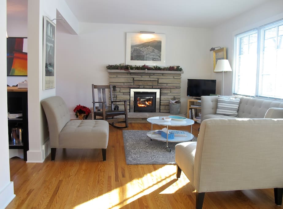 The sun streams in, and the fire lends its warmth to the living room on a wintery day.