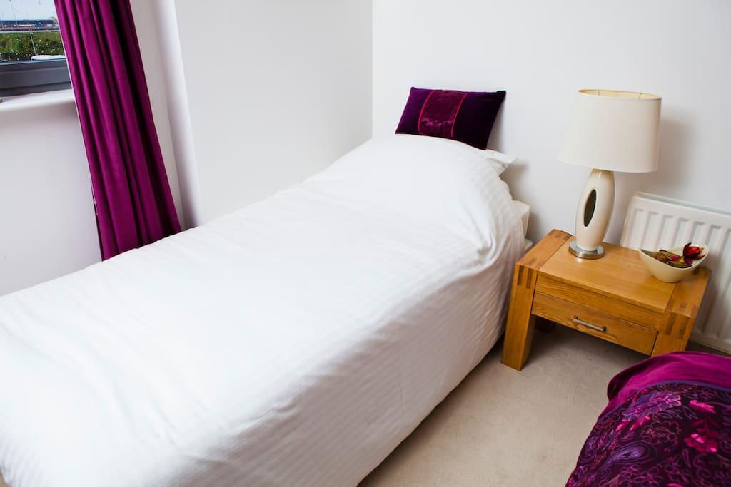 Single bed in guest bedroom