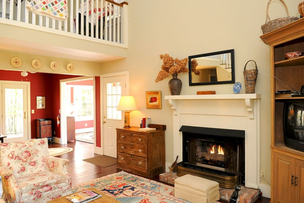 The comfortable and cozy living room has a gas fireplace.