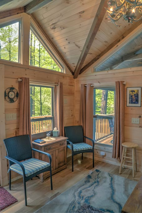 The sunlit great room is just a few steps away from the forest.