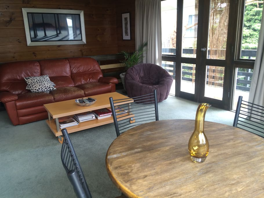 Upstairs open plan living arrea with balcony access.