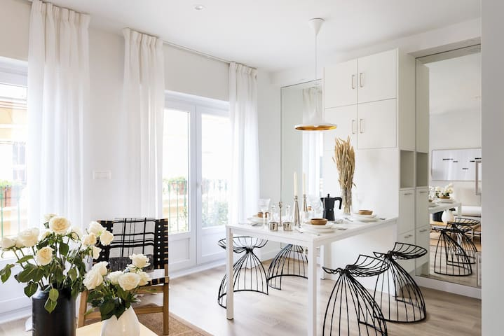 The Kitchen with everything you need and mirrors that multiply light and make you feel uplifted when you wake up in the morning.  You can hop to the balcony and have breakfast if you want to feel the nice sun of Alicante.