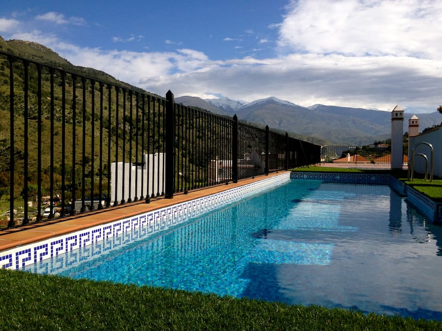 Rooftop pool. Always peaceful. Mountains in distance are snow-capped from November to April.