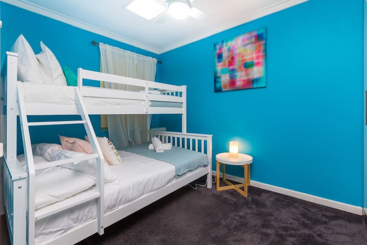 The second bedroom - complete with bunk bed - single over double & plenty of robe space for your belongings.