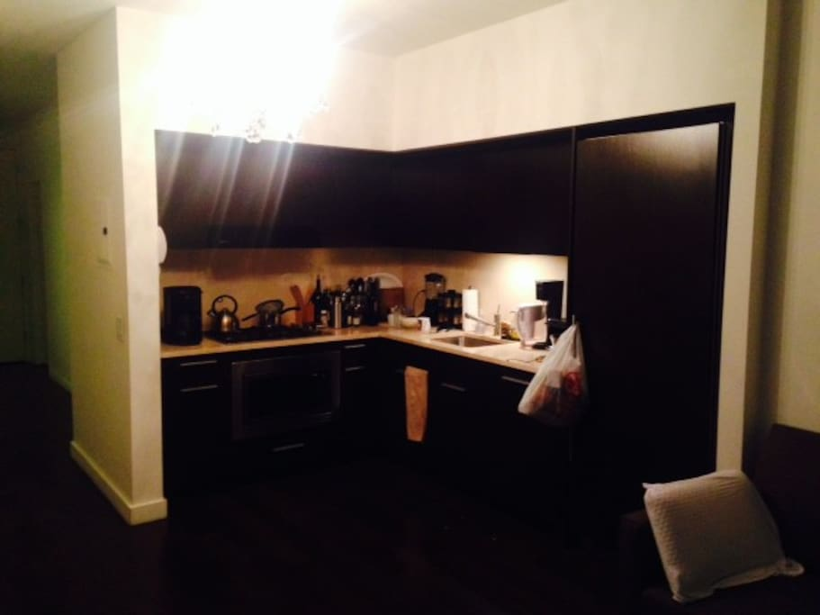 Full kitchen with fridge, microwave oven with oven function, dish washer, and coffee maker.