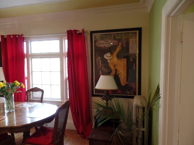 Vibrant artwork on the living rooms walls