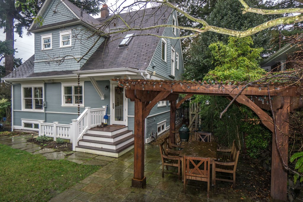 Back of house with arbor/patio area.