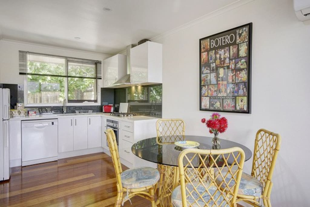 a fully equipped Kitchen, light and airy, Dining area and a courtyard garden
