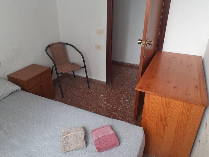 Habitación doble en piso compartido
