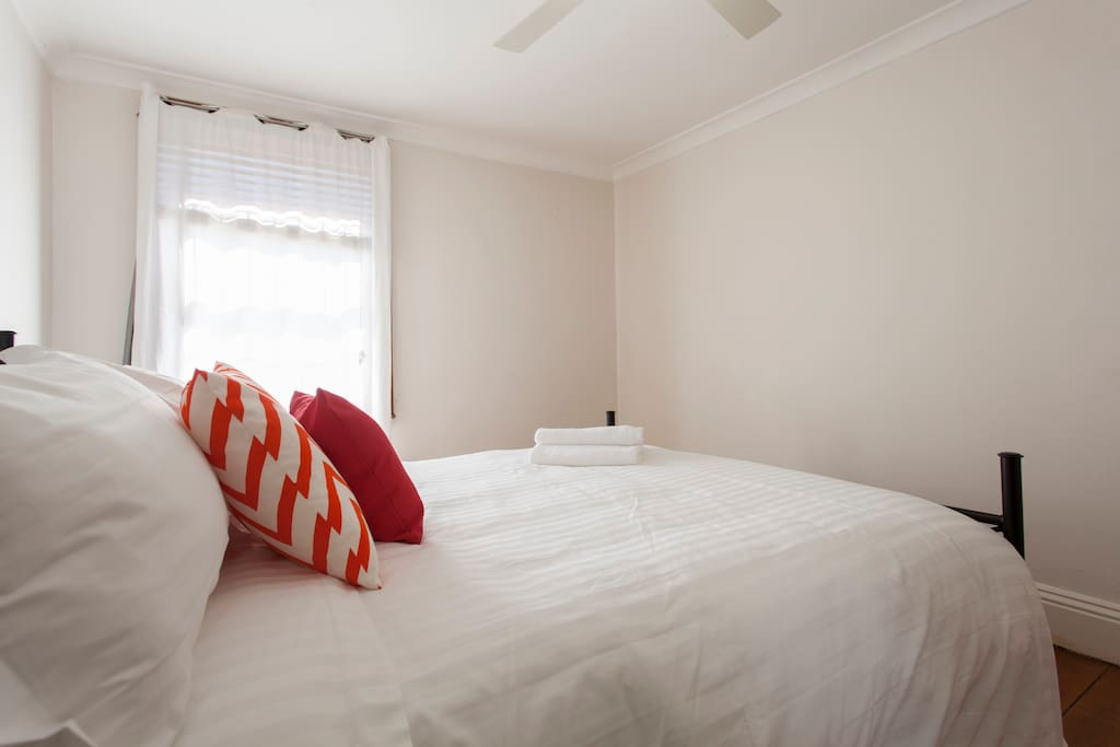 Your modern and clean bedroom with ceiling fan and light.