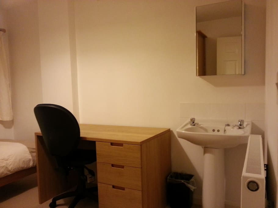 The room has it's own sink, and a nice writing desk.