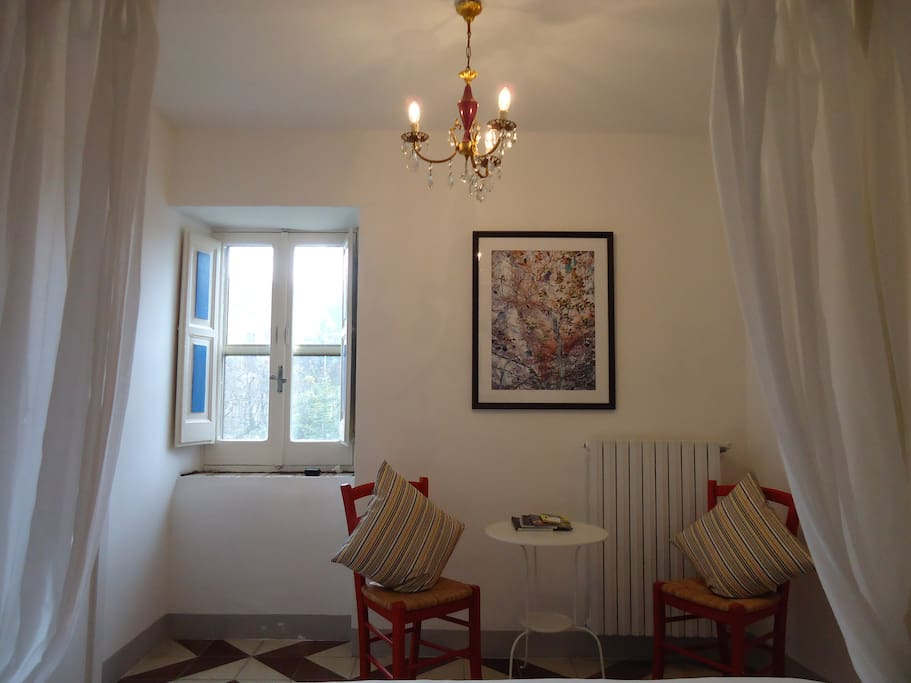 Malvasia is a double room with a queen size bed and en-suite bathroom with shower. It is located on the second floor and has a nice view over the garden.