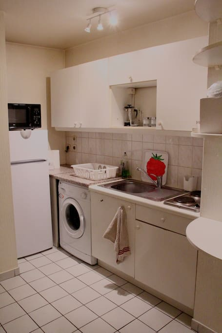 Fully equipped kitchen with microwave grill oven, fridge freezer, washing machine and all utensils