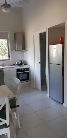 Kitchen includes a mid-size fridge