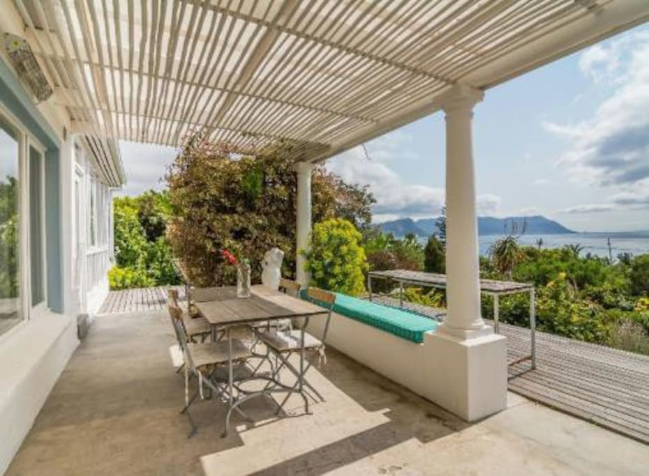 Lovely sun deck and glimpse of amazing view and garden. A lovely big wooden white table is now there - seats 14