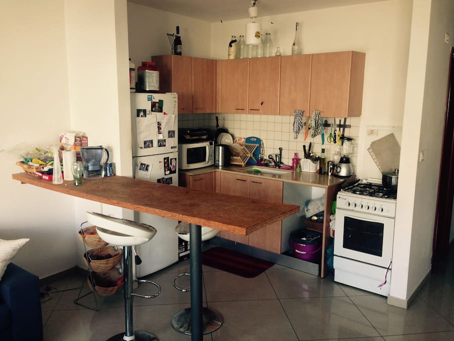 The kitchen and dining bar table.