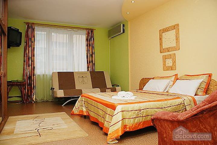 main room with tv, comfort bed and sofa