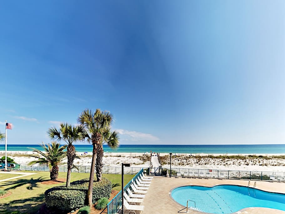 Take in spectacular Gulf and pool views from your private balcony.
