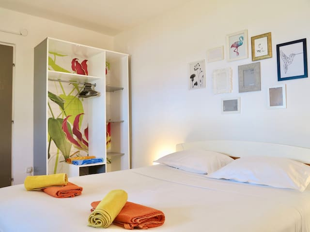 Bright air conditioned bedroom with unique touches
